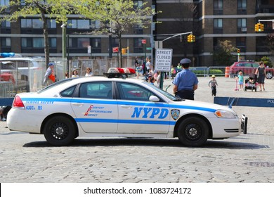 NEW YORK - MAY 3, 2018: NYPD School Safety Officer in front of school in Lower Manhattan