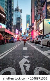 NEW YORK, NEW YORK - MAY 6: A man jogs through the bike lane near Times Square in New York City on May 6, 2012.