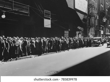 New York men in a bread line during the Great Depression, 1935-38. The sign read, 'Paid Up to this Point, Every Dollar pays for 20 More Meals. Men ahead of the sign are assured of a five-cent meal--th