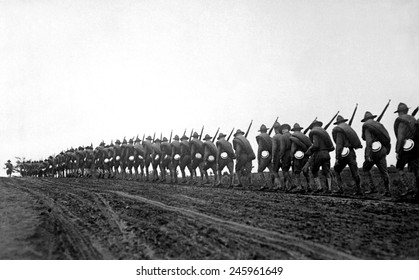 New York National Guard, silhouetted against the sky as they march to the training camp. WWI. Sept. 5, 1917.