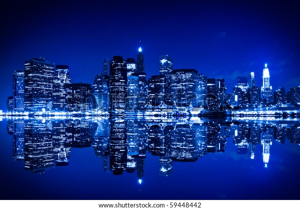 New York at night with reflection in water with blue hue