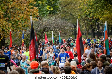 NEW YORK - NOV. 1: A large wave of runners heads into the last few miles of the 2015 TCS New York City Marathon at central park, new york on november 1, 2015