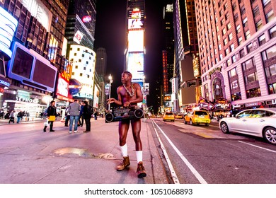 NEW YORK - NOV 11: Street performer in his underwear, holding a retro cassette player in Times Square, New-York, USA on November 11, 2012.