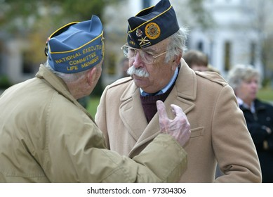NEW YORK - NOV 11: Veterans David Rivkin (R) of Jamaica Estates and Herbert Rosen of Kew Garden Hills speak at a Veteran's Day Memorial service at St. John's University November 11, 2005 in Queens.