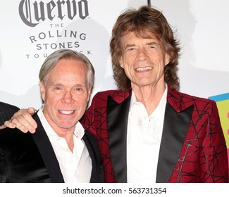 NEW YORK - NOV 15, 2016: Tommy Hilfiger and Mick Jagger attend the Rolling Stones Exhibitionism opening at Industria November 15, 2016, in New York City.