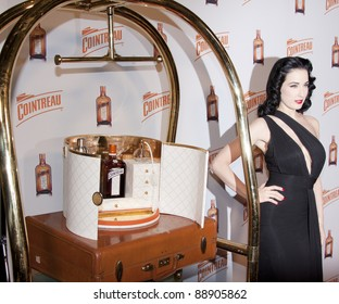 "NEW YORK - NOV 15: Dita Von Teese launches ""My Cointreau® Travel Essentials"" vintage-inspired travel bar, at Forty Four