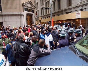 NEW YORK - NOV 17: Occupy Wall Street protesters and police face off on Wall Street, Lower Manhattan, on November 17, 2011 in New York City. Demonstrators marched to protest the financial system.