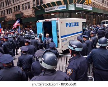 NEW YORK - NOV 17: Police stand guard after arresting Occupy Wall Street demonstrators at Beaver Street and Broad Street, on November 17, 2011 in New York City. Anti-bank marchers had blocked traffic.