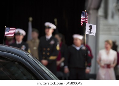 NEW YORK - NOV 25 2015: Close up of the American Flag and Wounded Warrior Project Flag attached to the antenna of a parade vehicle during the Americas Parade up 5th Avenue on Veterans Day in New York.
