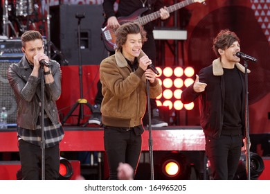NEW YORK - NOV 26: Liam Payne, Harry Styles and Louis Tomlinson of One Direction perform on 'Good Morning America' in Central Park on November 26, 2013 in New York City.