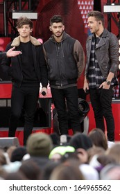 NEW YORK - NOV 26: Louis Tomlinson, Zayn Malik and Liam Payne of One Direction perform on 'Good Morning America' in Central Park on November 26, 2013 in New York City.