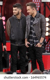 NEW YORK - NOV 26: Zayn Malik and Liam Payne of One Direction perform on 'Good Morning America' in Central Park on November 26, 2013 in New York City.
