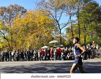 NEW YORK - NOV. 7: The crowd cheers for an unidentified NYPD police officer as he runs past in Central Park along the last few miles of the 2010 New York City Marathon on Nov. 7, 2010 in New York, NY.