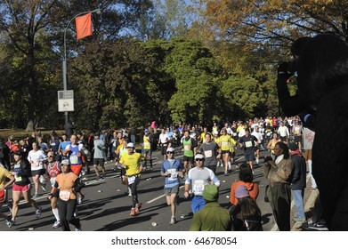 NEW YORK - NOV. 7:  A large wave of runners heads into the last few miles of the 2010 New York City Marathon just past Mile 24 in Central Park on Nov. 7, 2010 in New York, New York.