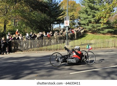 NEW YORK - NOV. 7:  An unidentified hand cyclist (wheeler) with a prosthetic leg cycles the last few miles of the 2010 New York City Marathon in Central Park on Nov. 7, 2010 in New York, NY