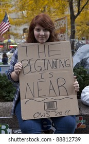 NEW YORK - NOVEMBER 14: Unidentified protester with 'Occupy Wall Street' with sign on November 14, 2011 in New York.