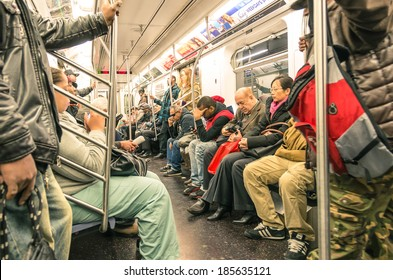 NEW YORK - NOVEMBER 2, 2013: mixed people in the subway, downtown Manhattan. The trains are the places where the most mixed melting pot in the world take place, and the real mirror of actual society.