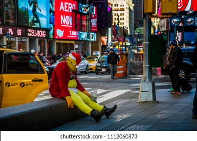 NEW YORK – NOVEMBER 22, 2014. The hero of the Simpsons cartoon - Homer Jay Simpson rests on the curb of Times Square after a day's work.