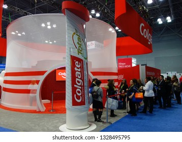 NEW YORK - NOVEMBER 27, 2018: Colgate booth at the Greater NY Dental Meeting in New York. Colgate is an oral hygiene product line of toothpastes, toothbrushes, mouthwashes and dental floss