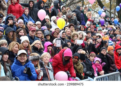 NEW YORK - NOVEMBER 27: Spectators attend the 88th Annual Macy's Thanksgiving Day Parade on November 27, 2014 in New York City.