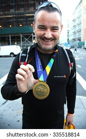 NEW YORK - NOVEMBER 3, 2015: Unidentified New York City Marathon runner wears medal in Manhattan. The TCS New York City Marathon is one of the world s most iconic races