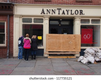 NEW YORK, NOVEMBER 3: Passersby inspect a damaged Ann Taylor store at the Seaport in New York City, November 3, 2012. Lower Manhattan was seriously damaged by flooding from Hurricane Sandy.