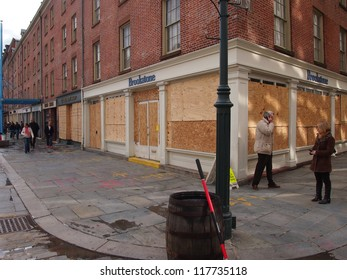 NEW YORK, NOVEMBER 3: Plywood covers storefronts at the South Street Seaport in New York City, November 3, 2012. Lower Manhattan was seriously damaged by flooding from Hurricane Sandy.