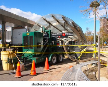 NEW YORK, NOVEMBER 3: A pump runs outside a flooded subway station in New York City, November 3, 2012. Lower Manhattan was seriously damaged by flooding from Hurricane Sandy.