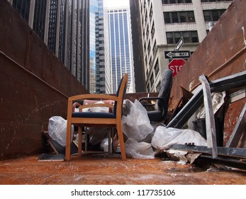 NEW YORK, NOVEMBER 3: Ruined office furniture sits in a dumpster in the Financial District of New York City, November 3, 2012. Lower Manhattan was seriously damaged by flooding from Hurricane Sandy.