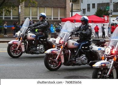 NEW YORK - NOVEMBER 5, 2017: NYPD officers on motorcycles providing security during New York City marathon. New York Police Department, established in 1845, is the largest police force in USA