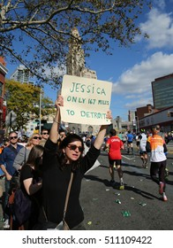 NEW YORK - NOVEMBER 6, 2016: Spectator supports New York City Marathon runners with sign. It traverse 26.2 miles through all five NYC boroughs to the finish line in Central Park, Manhattan