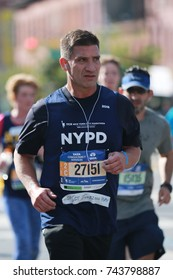 NEW YORK - NOVEMBER 6, 2016: New York City Marathon runners traverse 26.2 miles through all five NYC boroughs to the finish line in Central Park, Manhattan