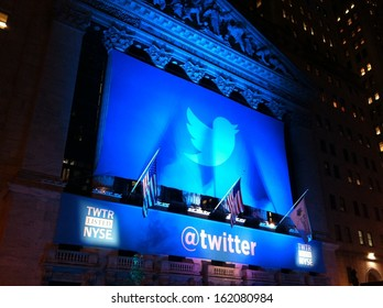 NEW YORK - NOVEMBER 7: The Twitter logo is shown in front of the NYSE on evening of its IPO on November 7, 2013 in New York. Twitter, ticker symbol: TWTR, went public today at $26 per share.