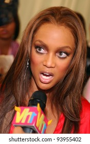 NEW YORK - NOVEMBER 9: Victoria's Secret Fashion model  Tyra Banks getting ready backstage during the 2010 Victoria's Secret Fashion Show on November 9, 2005 at the Lexington Armory in New York City.