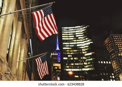 NEW YORK, NY - 03 December, 2016: American flag waving from Manhattan's (New York) buildings at night
