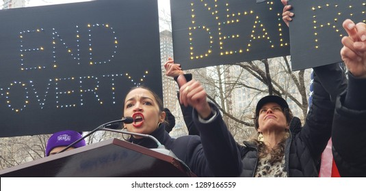 New York, NY - 1.19.2019: Women's March 2019 has gathered a huge Crowd today in Columbus Circle at 11am. With congresswoman Alexandria Ocasio-Cortez as one of the speakers.