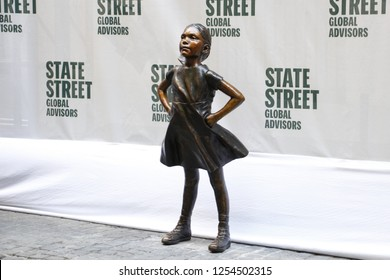 New York, NY - 12.10.2018 : Unveiling of the new, permanent location of Fearless Girl statue. She is now facing NYSE in downtown Manhattan.
