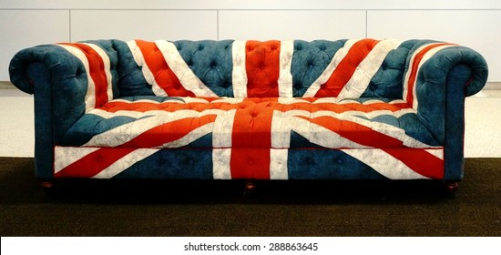 NEW YORK, NY -25 MAY 2015- A traditional Chesterfield sofa covered in fabric representing the United Kingdom Union Jack on display at the check-in counter for British Airways (BA) at JFK airport.