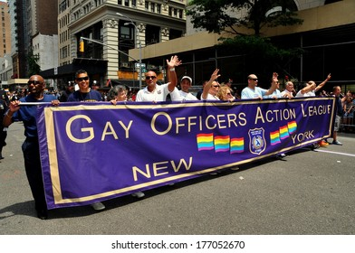 New York, NY - 30 June 2013:  Members of the Gay Officers Action League marching behind their banner at the annual Gay Pride Parade on Fifth Avenue