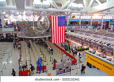 NEW YORK, NY -9 AUG 2017- View of a giant American flag inside Terminal 1 at the John F. Kennedy International Airport (JFK).