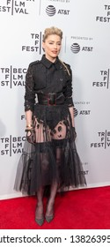 New York, NY - Apr 27, 2019: Amber Heard wearing dress by Claes Iversen, shoes by Christian Louboutin, purse by Tyler Ellis attends world premiere of Gully during Tribeca Film Festival at SVA Theatre
