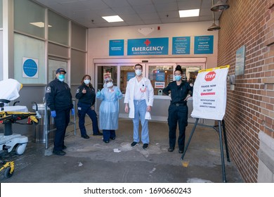 New York, NY - April 1, 2020: Frontline hospital workers pose in front of emergency room at Maimonides Medical Center in Brooklyn where patients for COVID-19 have been treated