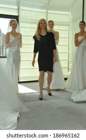 NEW YORK, NY - APRIL 11: Designer Justina McCaffrey and models posing for presentation during the Justina McCaffrey Spring 2015 Bridal collection show at on April 11, 2014 in New York City.