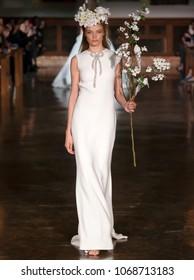 NEW YORK, NY - April 12, 2018: A model walks the runway at the Reem Acra Bridal Spring 2019 Collection Runway Show during NY Fashion Week Bridal