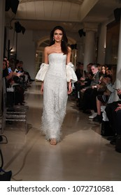 NEW YORK, NY - APRIL 12: A model walks the runway during the Oleg Cassini Spring 2019  Bridal fashion show on April 12, 2018 in New York City.