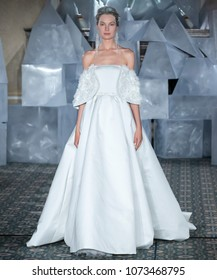 NEW YORK, NY - April 12, 2018: A model walks the runway at the Mira Zwillinger Bridal Spring 2019 Collection Show during NY Fashion Week Bridal