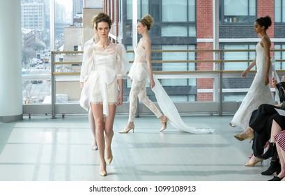 NEW YORK, NY - April 12, 2018: Models walk the runway at the Gracy Accad Bridal Spring 2019 Collection Runway Show during NY Fashion Week Bridal