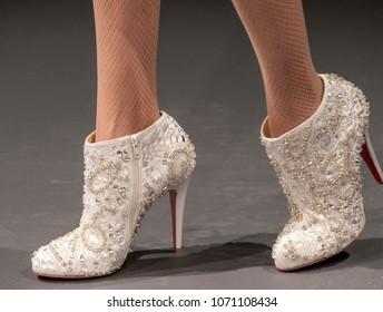 NEW YORK, NY - April 13, 2018: A model (shoes detail) poses at the Naeem Khan Bridal Spring 2019 Collection Presentation Show during NY Fashion Week Bridal