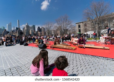 New York, NY - April 13, 2019: Miyabi Koto Shamisen Ensemble performs at festival while New Yorkers and tourists alike enjoy Cherry Blossom Festival on Roosevelt Island