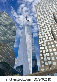 NEW YORK, NY - APRIL 14, 2018: Clouds reflect in the glass windows of Freedom Tower and surrounding skyscrapers in downtown Manhattan.